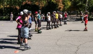 People on roller skates beating a sedentary lifestyle.