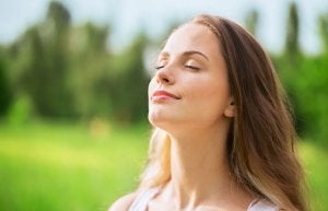 Woman breathing to reduce stress.
