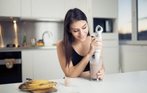 Woman making protein shakes at home.