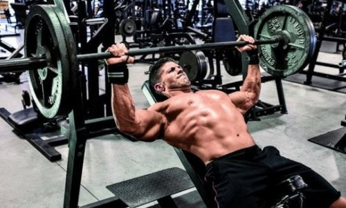 Man doing bench press essential exercises for starting at the gym