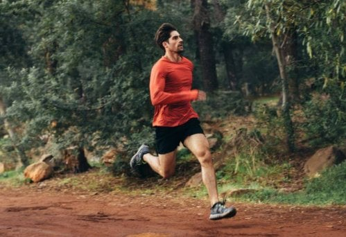 Man in red shirt trail running