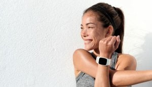 Woman running with one of the best smartwatches.