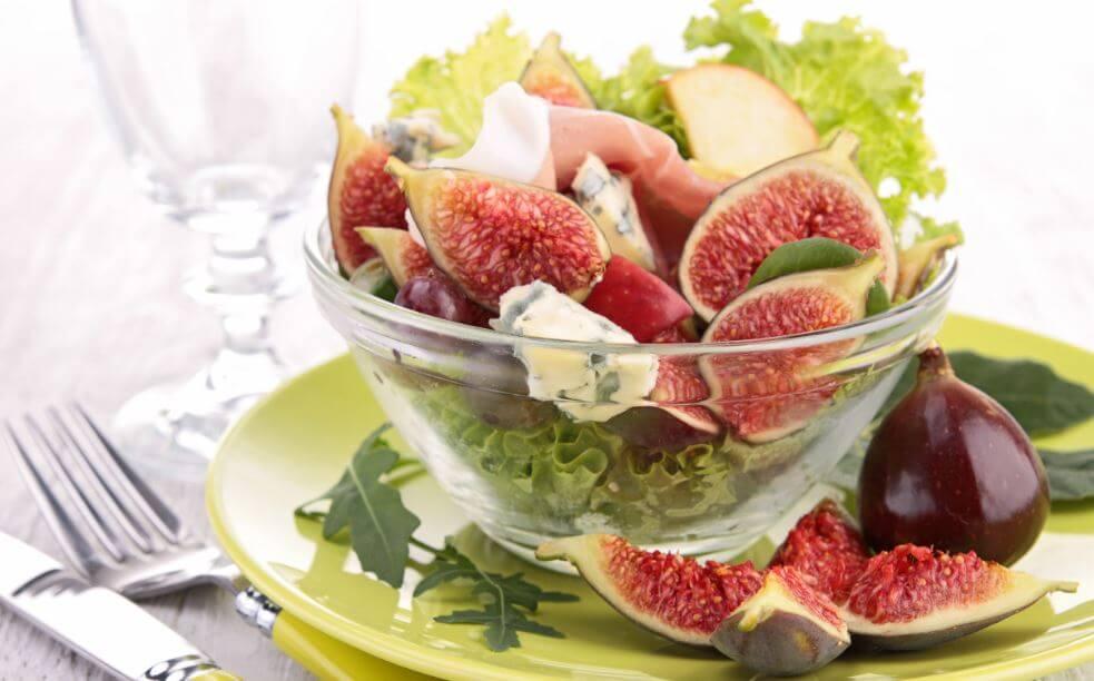 Figs serrano ham and lettuce in clear bowl three salad recipes