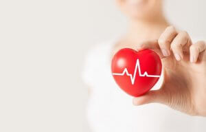 Woman holding heart monitor