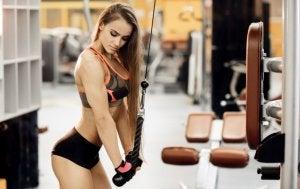 Woman using weight machine