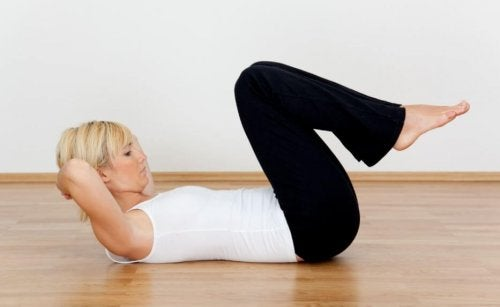 Woman doing situps on floor work out at home