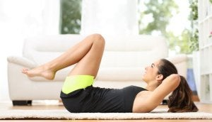Woman doing abs workout at home.