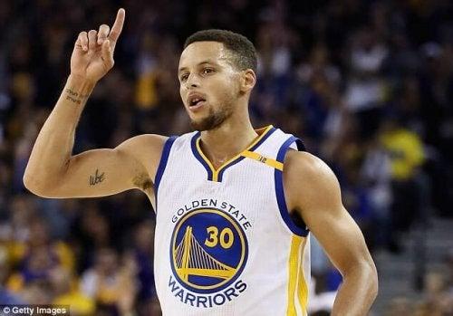 Stephen Curry raising his finger.