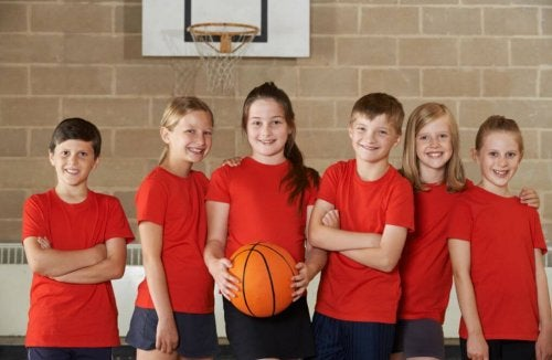 Attention deficit hyperactivity disorder kids playing basketball on a team