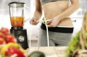Woman making a post-workout smoothie