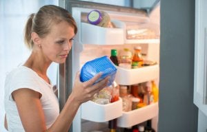 Woman choosing food from the fridge.