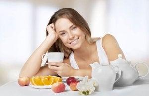 Woman having breakfast before training