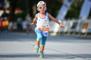A little kid competing in a race