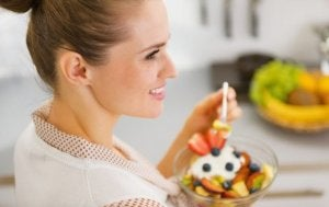 Woman eating a healthy surfer's diet