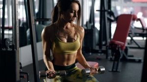 Woman with toned muscles lifting weights