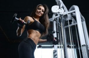 Woman doing the dumbbell upright row