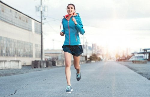 Woman running outside on street get rid of love handles