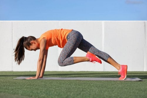 Mountain climbers woman exercising on a field