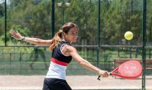 Woman playing paddle tennis outside