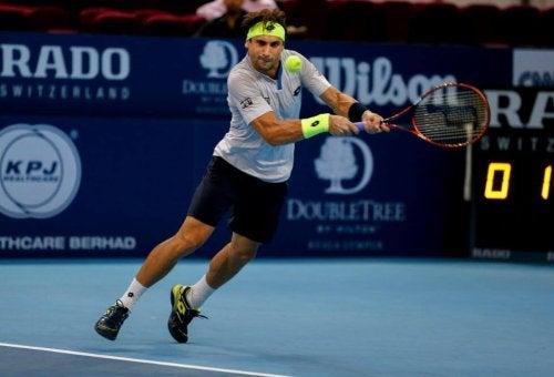 David Ferrer hitting a tennis backhand