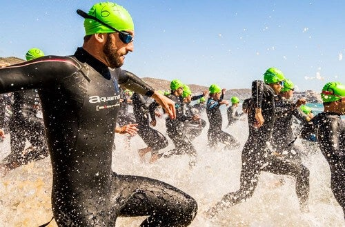 Swimmers entering water