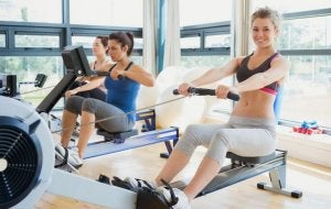 Women using rowing machines at the gym