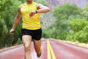 Man using a wrist heart rate monitor while running