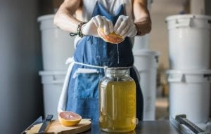 Woman using the food fermentation process to make vinegar