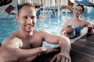 Couple staying healthy and thin during their vacations by swimming