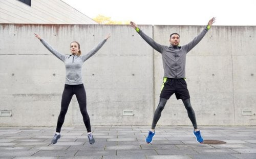 Couple exercising outside jumping tbc session cardio