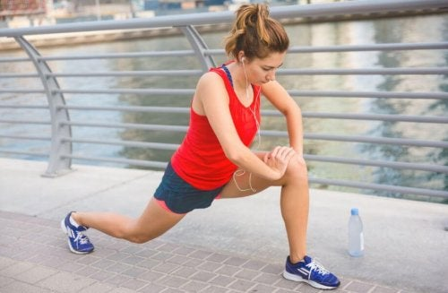 Woman stretching on waterfront stretches for tight hamstrings