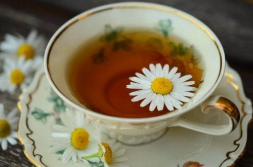 Cup and saucer of chamomile tea