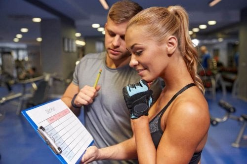 Woman planning her workouts with her trainer getting the results she wants