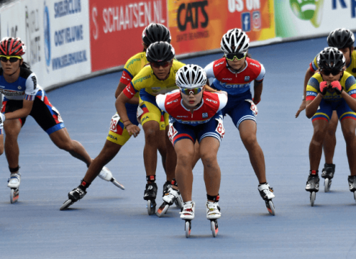 Professional athletes competing in speed skating inline on track