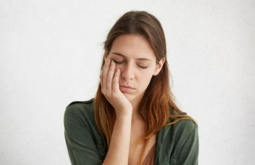 Woman leaning on hand falling asleep exhausted