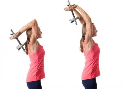 Woman lifting one dumbbell with both arms behind head