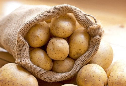 Burlap bag full of fresh potatoes
