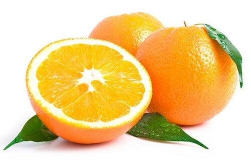 Three oranges one halved