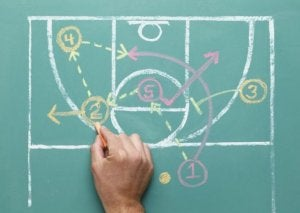 Drawing the pick and roll play on a chalkboard