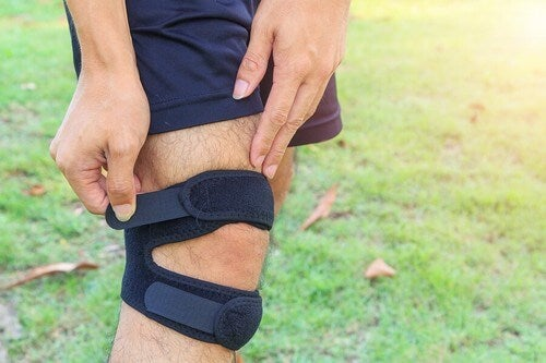 Man's knee with knee strap