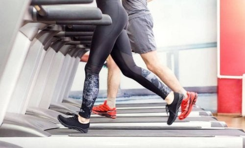 Man and woman's legs on treadmill