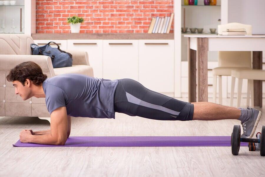 man doing plank abdomen exercise