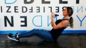 Sit-ups with a kettlebell