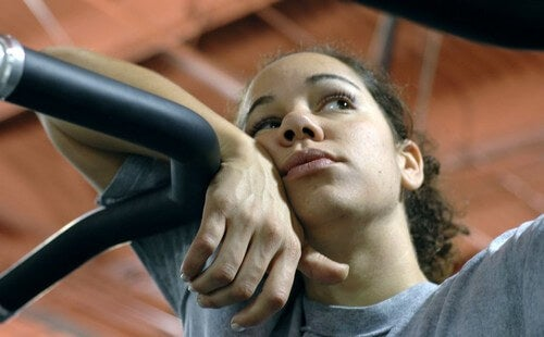 Woman looking bored on exercise machine