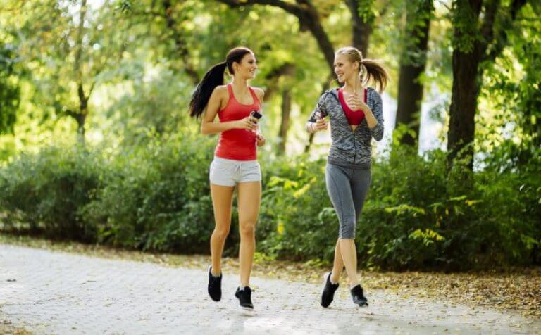 Two women doing sports to release their stress