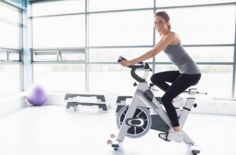 A woman riding a static bike