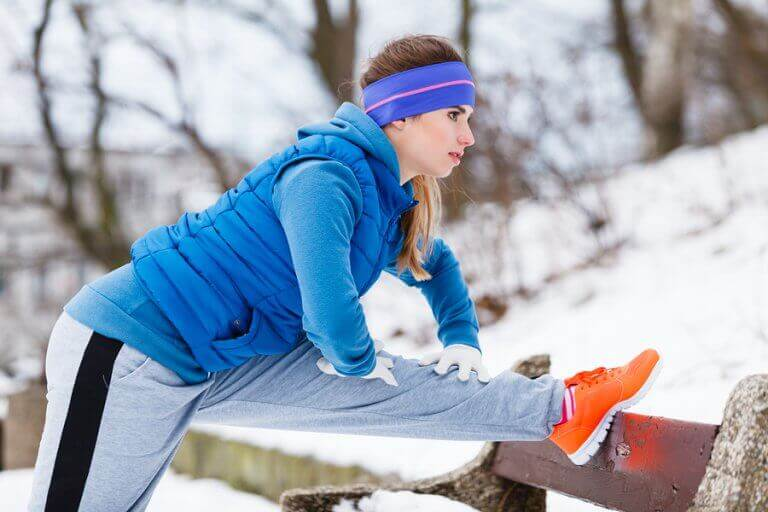 A girl with warm clothes working out during the winter