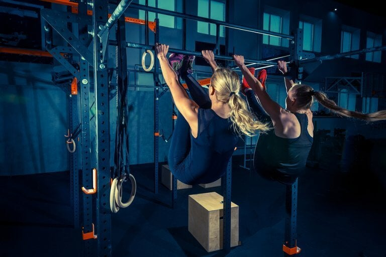 Two womem in the middle of their crossfit routine