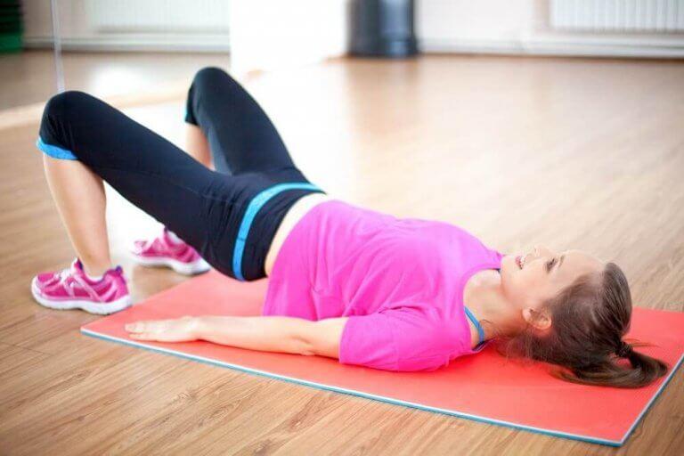 A woman doing kegel exercises to strengthen her pelvic floor