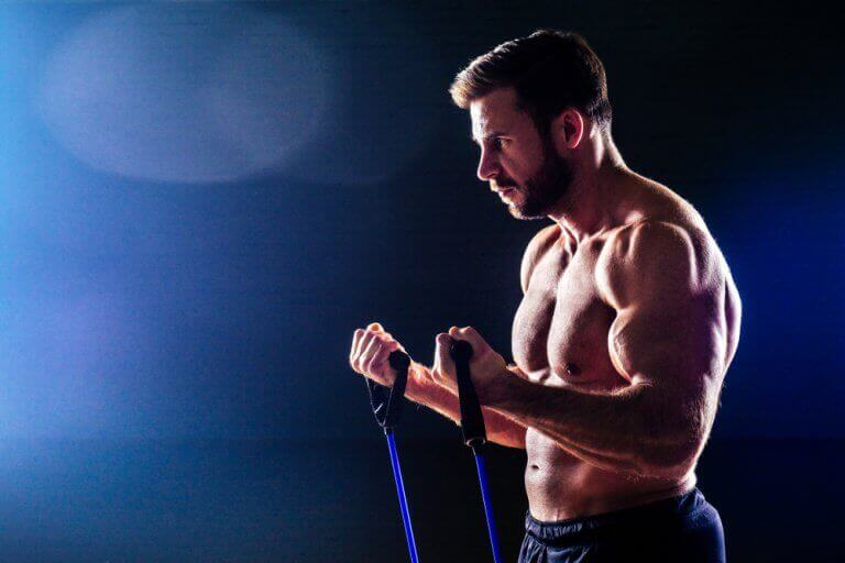 A man performing arm exercises with a resistance band